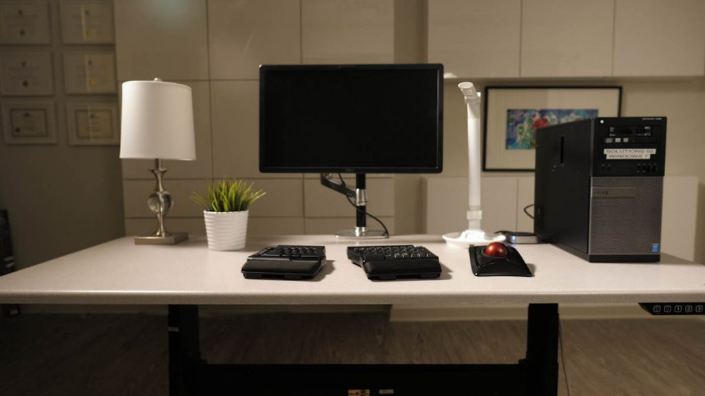 Desk with computer and assistive technology equipment