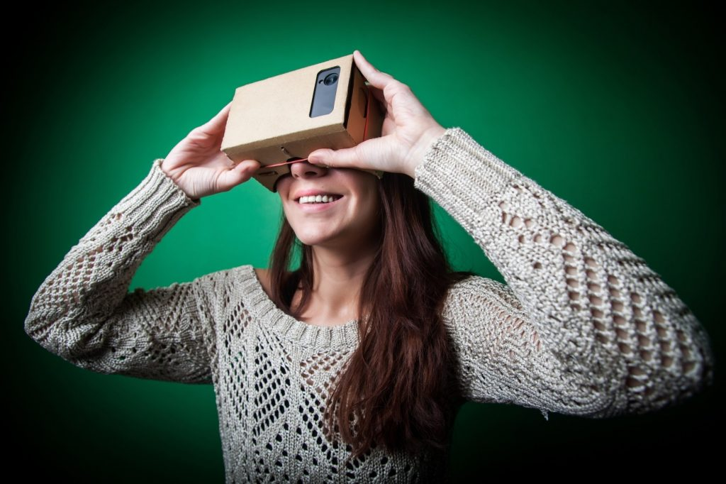 A woman using Google Cardboard - Copy